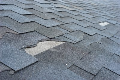 Close Up of Loose and Missing Asphalt Roof Shingle